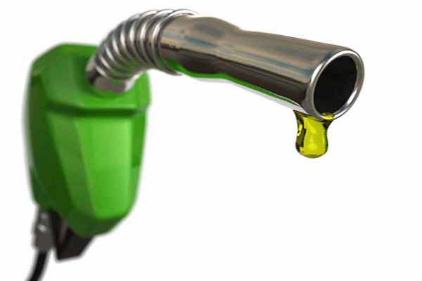 A fuel pump nozzle with a drop of petrol. Very high resolution 3D render.